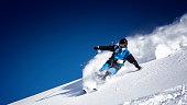 Expert skier showing skills