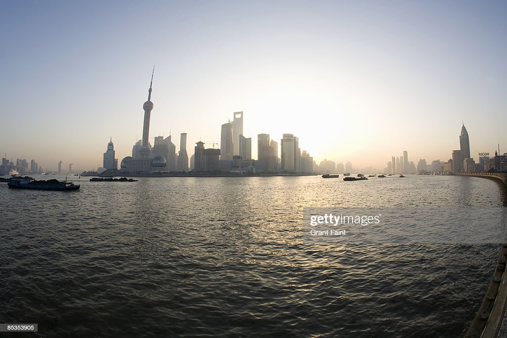 Extreme wide view of river and business district : Stock Photo
