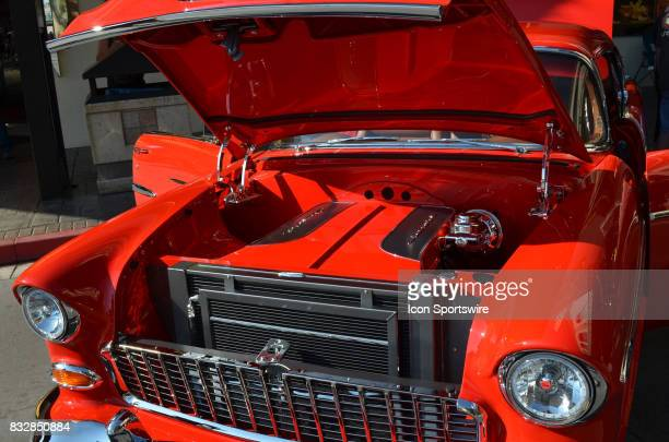 Extremely clean engine compartment with matching paint on this 1955 Chevy Bel Air on display at the Hot August Nights Custom Car Show the largest...