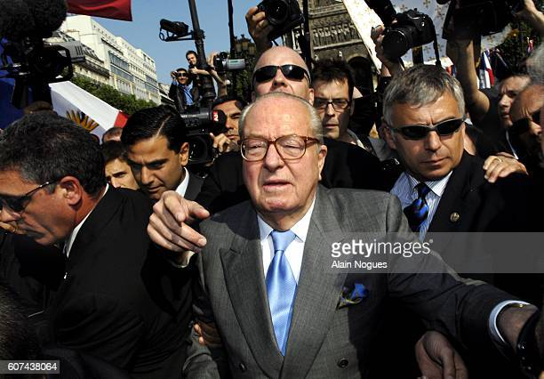 Extremist rightwing leader JeanMarie Le Pen marches towards the Place de l'Opera surrounded by bodyguards to deliver his traditional May Day speech...