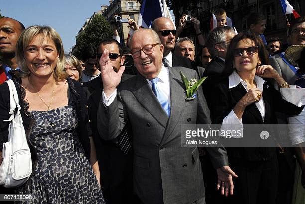 Extremist rightwing leader JeanMarie Le Pen marches towards the Place de l'Opera with his daughter Marine and wife to deliver his traditional May Day...