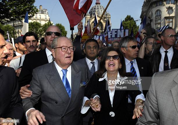 Extremist rightwing leader JeanMarie Le Pen marches towards the Place de l'Opera with his wife to deliver his traditional May Day speech in Paris