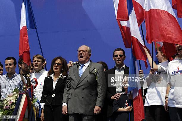 Extremist rightwing leader JeanMarie Le Pen sings the French national anthem the Marseillaise in the company of his wife at his traditional May Day...