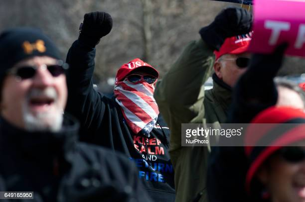 Extremist supporter of the current US President is seen in the crowd at a proTrump rally in Bensalem PA on March 4th 2017 Similar small events were...