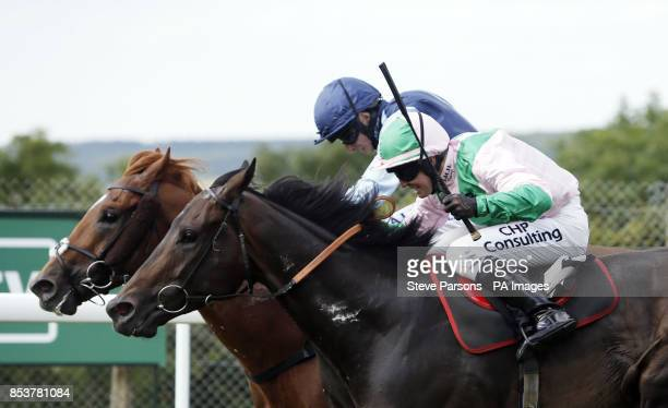 Extremity ridden by Ryan Moore beats Buckstay ridden by Jim Crowley to win the bet365 stakes during day one of Glorious Goodwood West Sussex