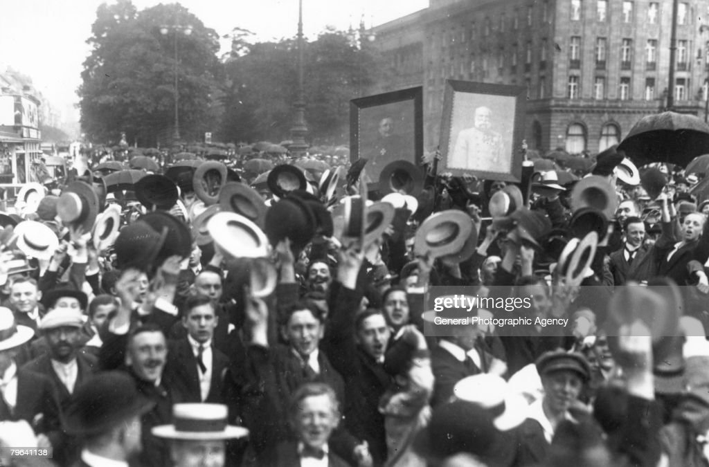 Exuberance on Unter den Linden in Berlin, following the declaration of war, 4th August 1914. A photograph of Kaiser Wilhelm II is visible in the background.