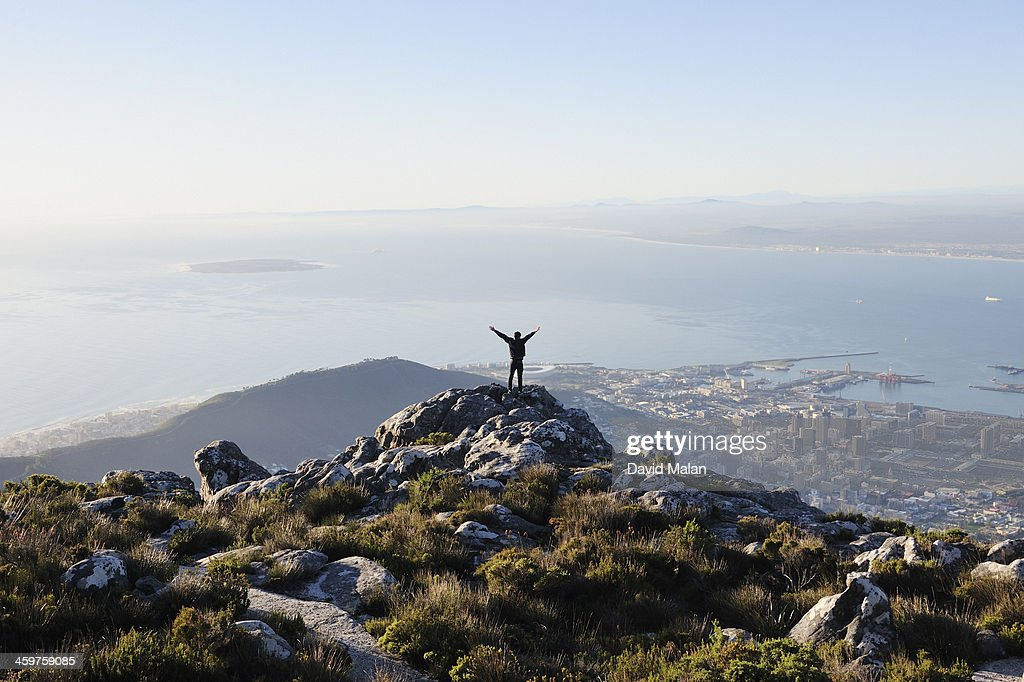 Exuberant man on top of Table Mountain