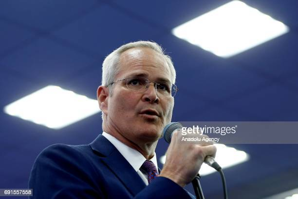 Exxon Chief Executive Officer Darren Woods delivers a speech during the 2017 St Petersburg International Economic Forum in St Petersburg Russia on...