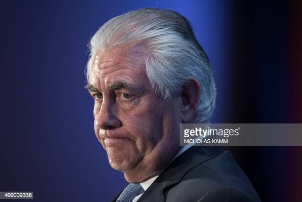 Exxon Mobil chairman and CEO Rex Tillerson looks on while speaking at a discussion organized by the Economic Club of Washington on the energy...
