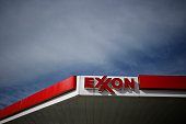 Exxon Mobil Corp signage is displayed at a gas station in Cincinnati Ohio US on Monday Jan 27 2014 Exxon Mobil Corp is scheduled to release their...