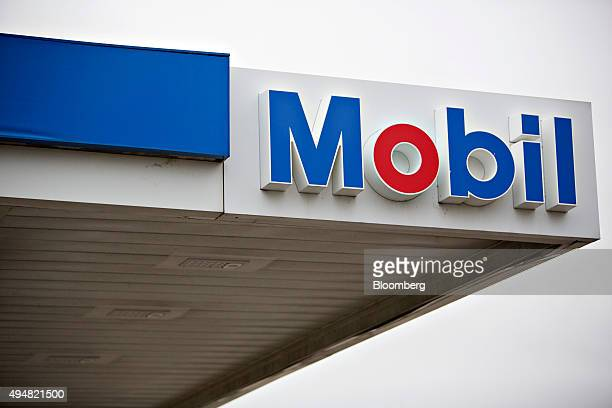 Exxon Mobil Corp signage is displayed at a gas station in Rockford Illinois US on Wednesday Oct 28 2015 Exxon Mobil Corp is scheduled to report...