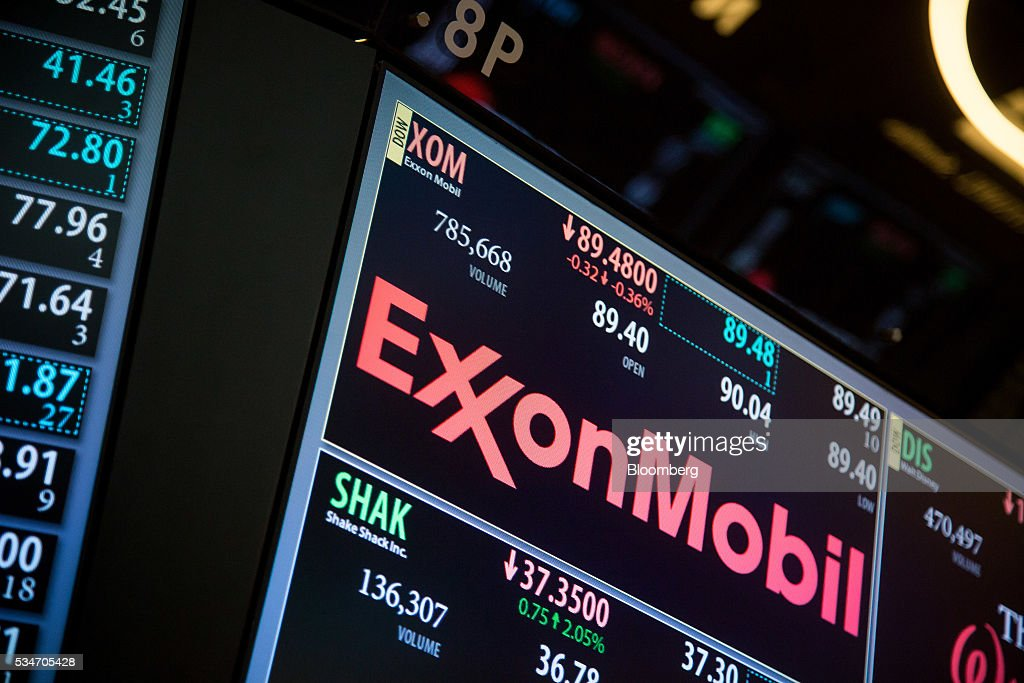 Exxon Mobil Corp. signage is displayed on a monitor on the floor of the New York Stock Exchange (NYSE) in New York, U.S., on Friday, May 27, 2016. U.S. stocks edged higher, with the S&P 500 on course for its biggest weekly advance since March, while investors awaited remarks from Federal Reserve Chair Janet Yellen for hints on the timing of the next interest-rate increase. Photographer: Michael Nagle/Bloomberg via Getty Images