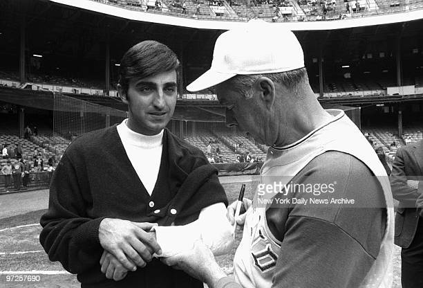ExYankee great Joe DiMaggio now Oakland A's coach signs cast of sidelined Joe Pepitone prior to game at Yankee Stadium