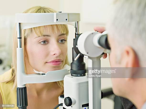 Eye doctor examining womanÕs vision