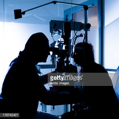 Eye doctor with patient : Stock Photo