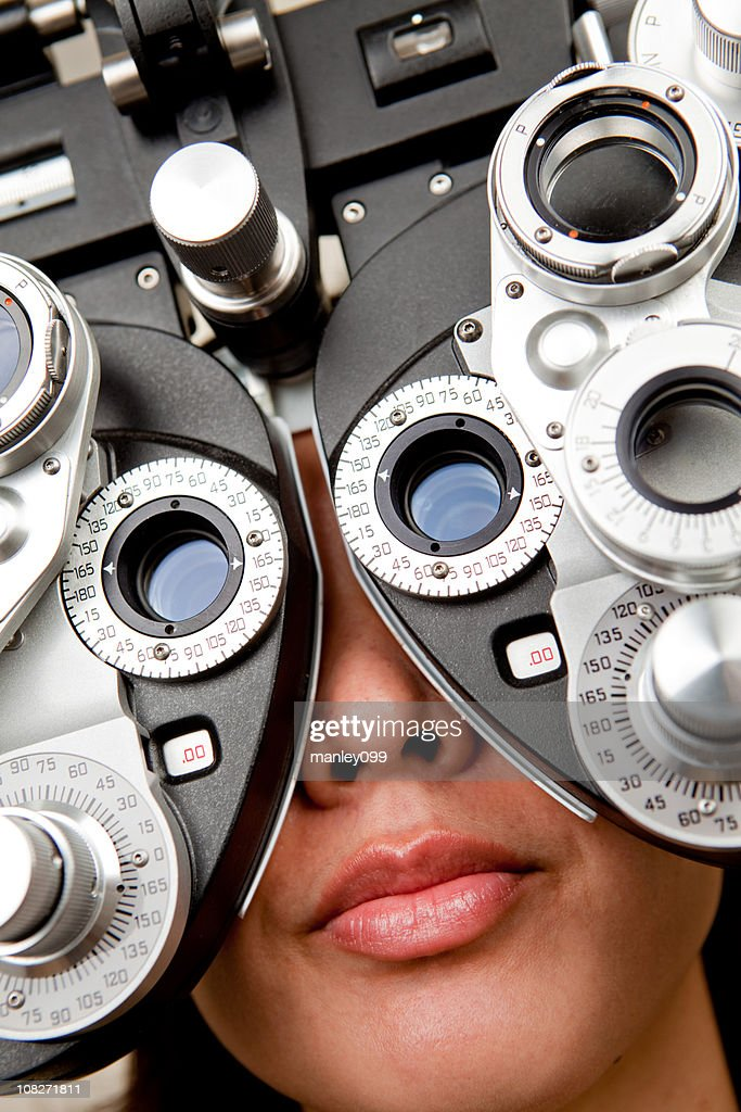eye exam at the optometry diopter : Stock Photo