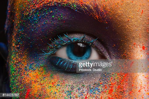 Eye of model with colorful art make-up, close-up : Stock Photo