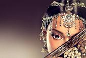 Beautiful Indian women portrait with jewelry.