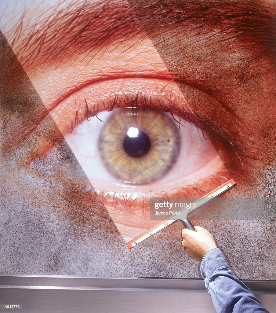 Eye on wall, squeegee cleaning image : Stock Photo