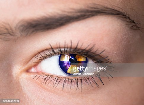 Eye with radiation symbol. : Stock Photo