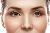Eye woman eyebrow eyes lashes. Studio shot.