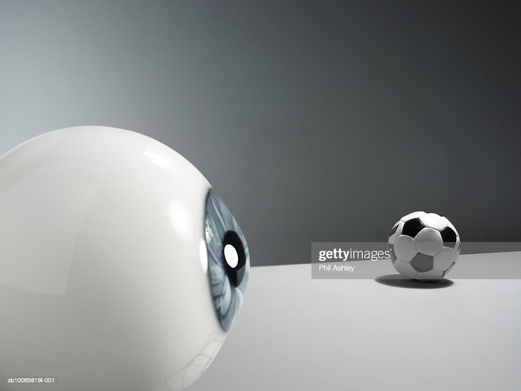 Eyeball and football on white background : Stock Photo