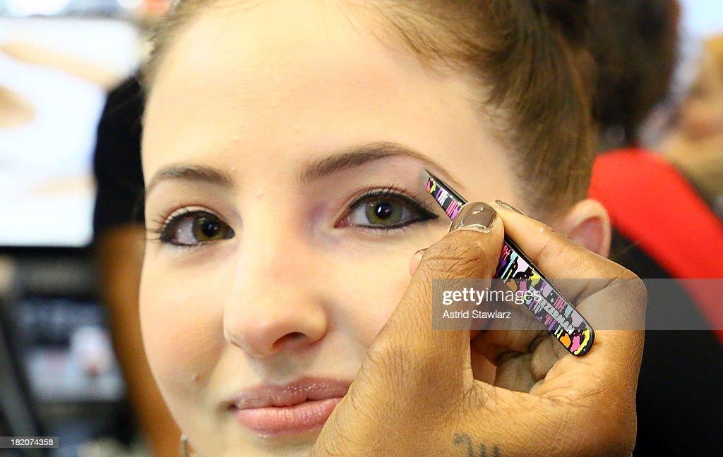 Eyebrows are tweezed using Tweezerman during the Tweezerman & Isaac Mizrahi event at Sephora Times Square on September 27, 2013 in New York City.