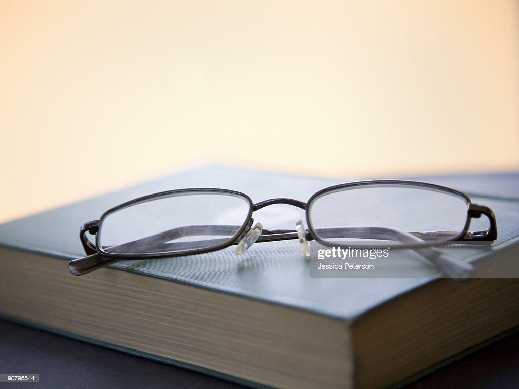 eyeglasses on a book : Stock Photo