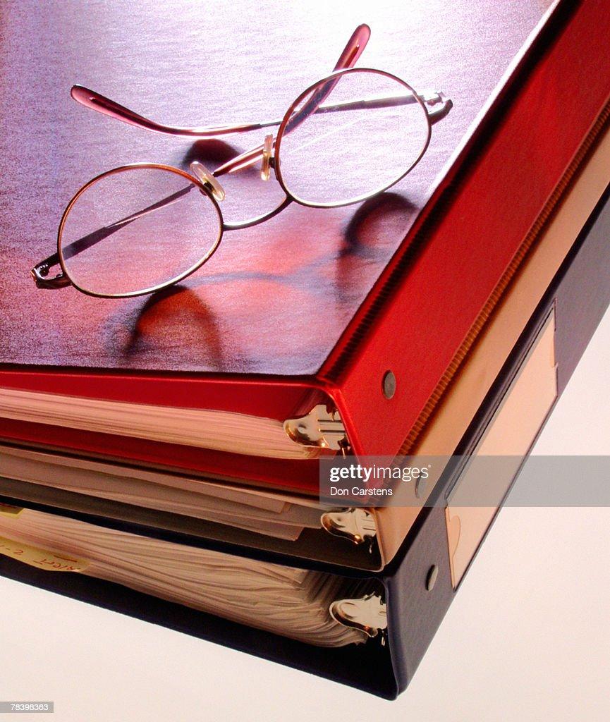 Eyeglasses on binders