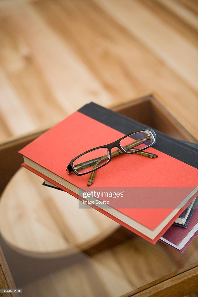 Eyeglasses on books : Stock Photo