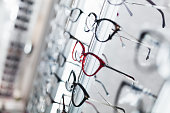 Close up shot of eyeglasses frames in optical store.