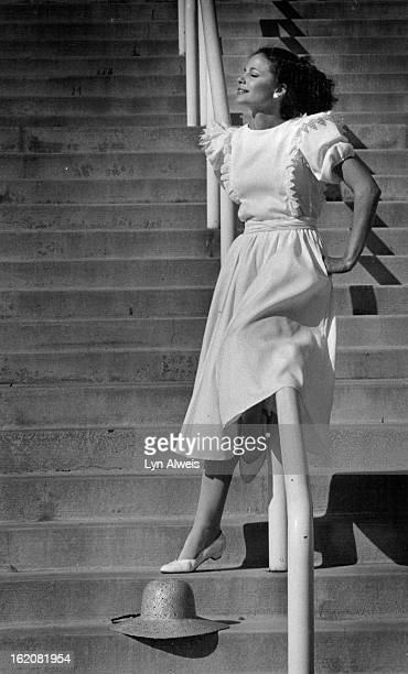 JUN 17 1982 Eyelet ruffles lend the effect of a pinafore top on Belle Franceé¦s cotton pique dress At right Dottie wears a sheer cotton polyester...