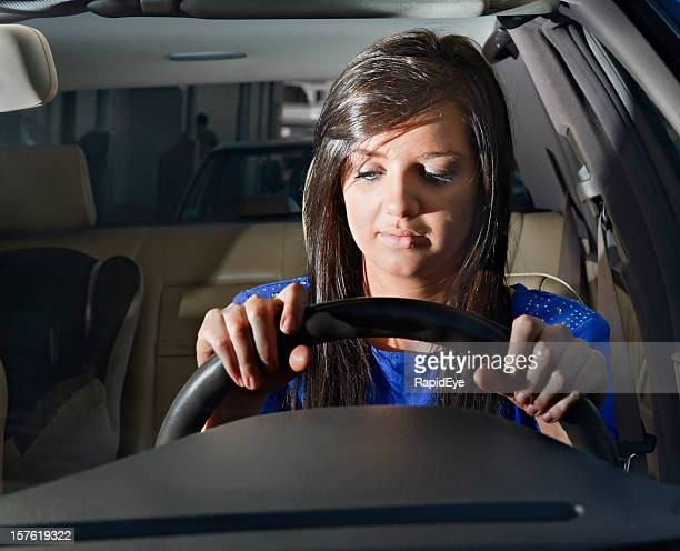 Eyelids drooping, this woman driver is sleepy or very bored