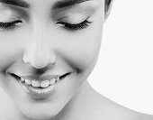 Eyes lashes closeup closed Beautiful woman face close up studio on white black and white
