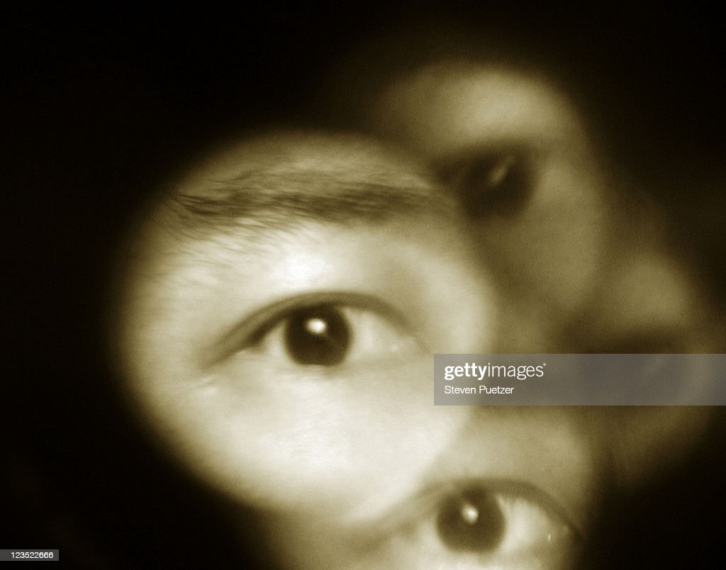Eyes looking through holes