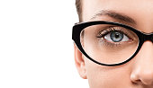 Cloese up of young woman wearing eyeglasses isolated on white background with cop space