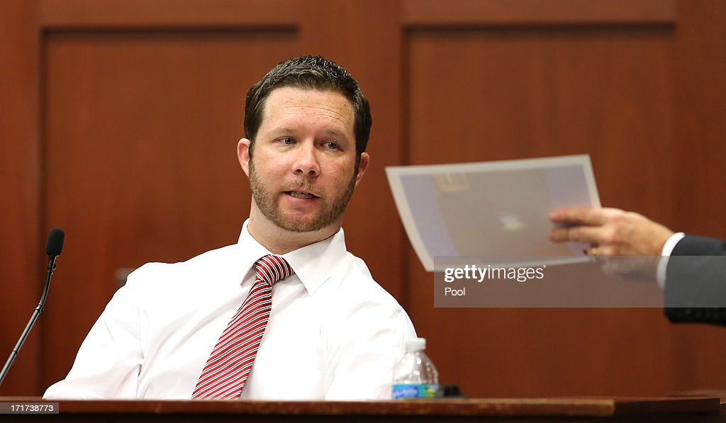 Eyewitness Jonathan Good is shown a photo of the body of Trayvon Martin at the crime scene by prosecutor Bernie de la Rionda during the 15th day of Zimmerman's murder trial in Seminole circuit court June 28, 2013 in Sanford, Florida. Zimmerman is charged with second-degree murder for the February 2012 shooting death of 17-year-old Trayvon Martin.