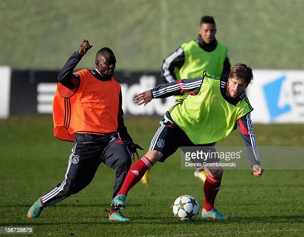Eyong Enoh of Amsterdam challenges teammate Lasse Schoene during a training session ahead of the UEFA Champions League match against Borussia...