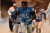 Ezekiel Ansah of the Detroit Lions and the defensive line take the field during player introductions prior to playing the Green Bay Packers at Ford...