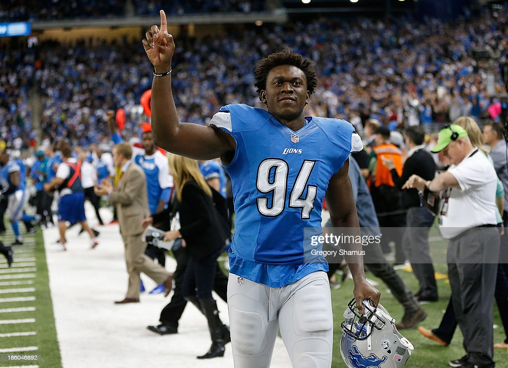 <a gi-track='captionPersonalityLinkClicked' href=/galleries/search?phrase=Ezekiel+Ansah&family=editorial&specificpeople=9750646 ng-click='$event.stopPropagation()'>Ezekiel Ansah</a> #94 of the Detroit Lions celebrates a 31-30 victory over the Dallas Cowboys at Ford Field on October 27, 2013 in Detroit, Michigan.