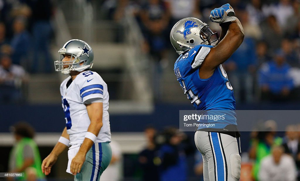 <a gi-track='captionPersonalityLinkClicked' href=/galleries/search?phrase=Ezekiel+Ansah&family=editorial&specificpeople=9750646 ng-click='$event.stopPropagation()'>Ezekiel Ansah</a> #94 of the Detroit Lions celebrates as <a gi-track='captionPersonalityLinkClicked' href=/galleries/search?phrase=Tony+Romo&family=editorial&specificpeople=756503 ng-click='$event.stopPropagation()'>Tony Romo</a> #9 of the Dallas Cowboys walks past during the second half of their NFC Wild Card Playoff game at AT&T Stadium on January 4, 2015 in Arlington, Texas.