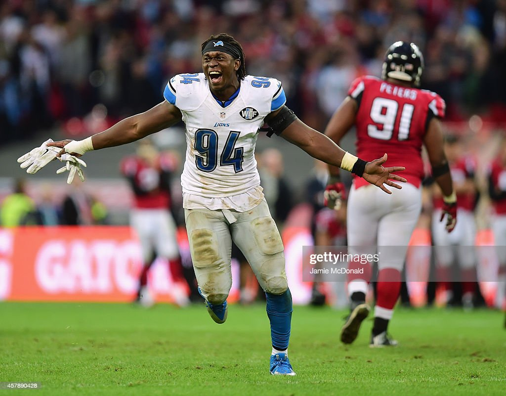 <a gi-track='captionPersonalityLinkClicked' href=/galleries/search?phrase=Ezekiel+Ansah&family=editorial&specificpeople=9750646 ng-click='$event.stopPropagation()'>Ezekiel Ansah</a> #94 of the Detroit Lions celebrates victory during the NFL match between Detroit Lions and Atlanta Falcons at Wembley Stadium on October 26, 2014 in London, England.