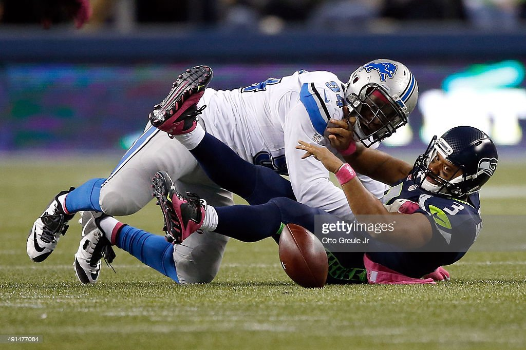 <a gi-track='captionPersonalityLinkClicked' href=/galleries/search?phrase=Ezekiel+Ansah&family=editorial&specificpeople=9750646 ng-click='$event.stopPropagation()'>Ezekiel Ansah</a> #94 of the Detroit Lions forces and recovers a fumble by <a gi-track='captionPersonalityLinkClicked' href=/galleries/search?phrase=Russell+Wilson+-+American+Football+Quarterback&family=editorial&specificpeople=2292912 ng-click='$event.stopPropagation()'>Russell Wilson</a> #3 of the Seattle Seahawks during the fourth quarter of their game at CenturyLink Field on October 5, 2015 in Seattle, Washington.