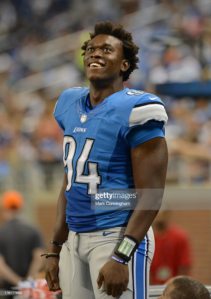 <a gi-track='captionPersonalityLinkClicked' href=/galleries/search?phrase=Ezekiel+Ansah&family=editorial&specificpeople=9750646 ng-click='$event.stopPropagation()'>Ezekiel Ansah</a> #94 of the Detroit Lions looks on from the sidelines and smiles during the game against the New York Jets at Ford Field on August 9, 2013 in Detroit, Michigan. The Lions defeated the Jets 26-17.