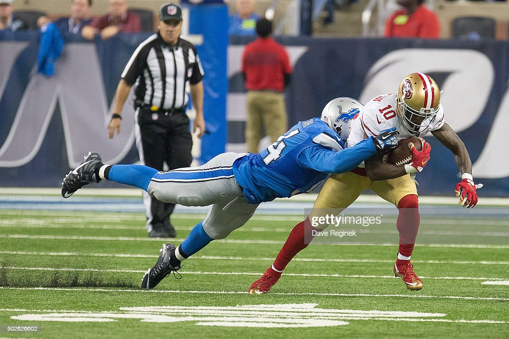 <a gi-track='captionPersonalityLinkClicked' href=/galleries/search?phrase=Ezekiel+Ansah&family=editorial&specificpeople=9750646 ng-click='$event.stopPropagation()'>Ezekiel Ansah</a> #94 of the Detroit Lions tackles <a gi-track='captionPersonalityLinkClicked' href=/galleries/search?phrase=Bruce+Ellington&family=editorial&specificpeople=7405384 ng-click='$event.stopPropagation()'>Bruce Ellington</a> #10 of the San Francisco 49ers during an NFL game at Ford Field on December 27, 2015 in Detroit, Michigan. The Lions defeated the 49ers 32-17.