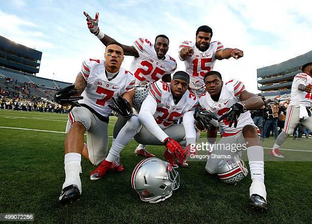 Ezekiel Elliott Bri'onte Dunn Jalin Marshall Chris Worley and Dontre Wilson of the Ohio State Buckeyes celebrate a 4213 win over the Michigan...
