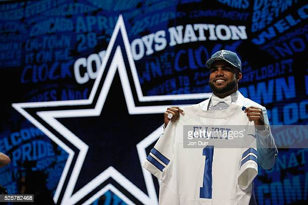 Ezekiel Elliott of Ohio State holds up a jersey after being picked overall by the Dallas Cowboys during the first round of the 2016 NFL Draft at the...