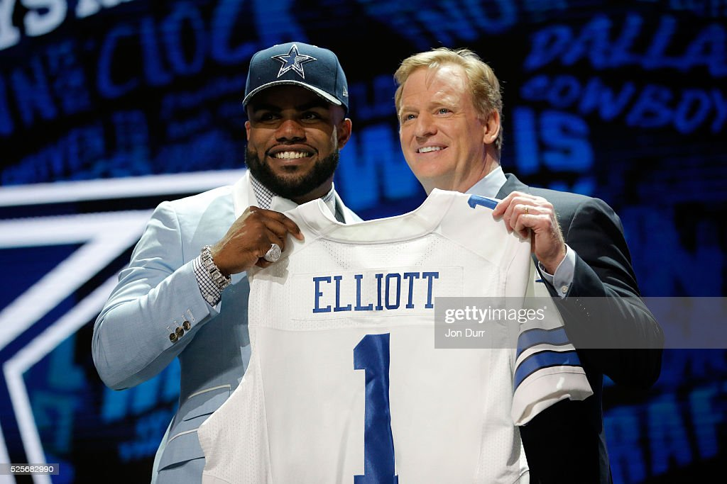 Ezekiel Elliott of Ohio State holds up a jersey with NFL Commissioner Roger Goodell after being picked overall by the Dallas Cowboys during the first...