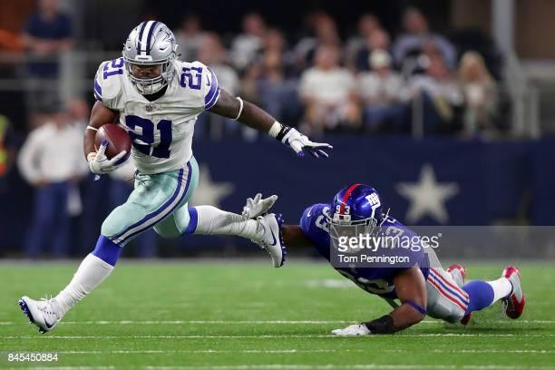 Ezekiel Elliott of the Dallas Cowboys carries the ball against BJ Goodson of the New York Giants in the second half at ATT Stadium on September 10...