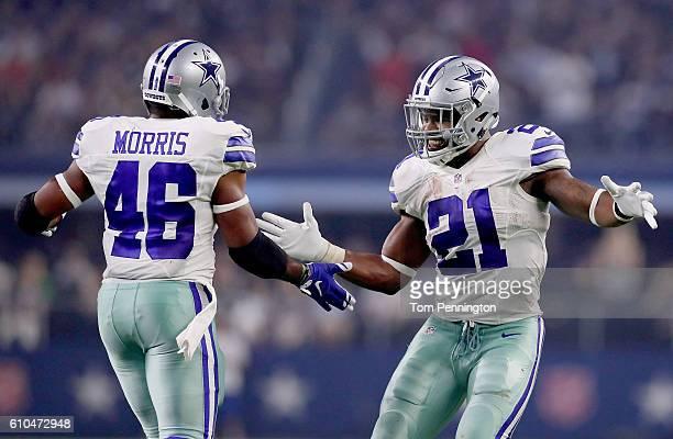 Ezekiel Elliott of the Dallas Cowboys celebrates with Alfred Morris of the Dallas Cowboys after Morris scored against the Chicago Bears in the second...